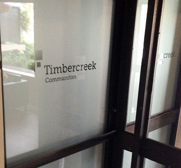 frosted vinyl company logo on office glass doors