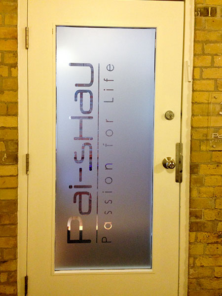 Frosted Vinyl on glass door application with the company logo cut out