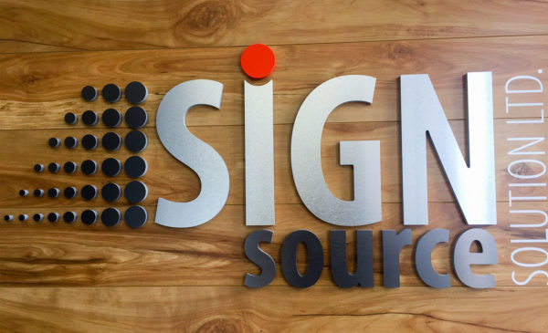 Brushed aluminum office logo sign