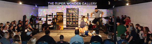 Sign Source Solution Makes Sports History with Hogtown Wrestling Event Signage in Toronto