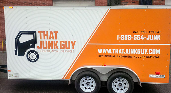 Large box or cargo trailer with a vinyl advertising wrap for Toronto junk removal company