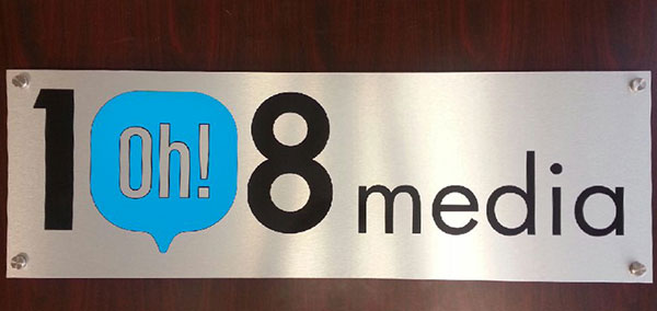 brushed aluminum office reception sign toronto