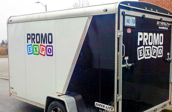 cargo-trailer-with-vinyl advertisment and logo